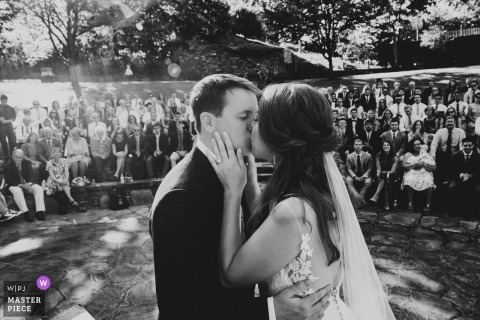 The North Carolina Arboretum Outdoor Wedding Ceremony - The Bride and Groom Kiss