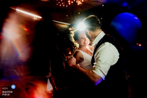 Baden-Wurttemberg Wedding Photojournalist | Germany reception party with the bride and groom dancing under lights