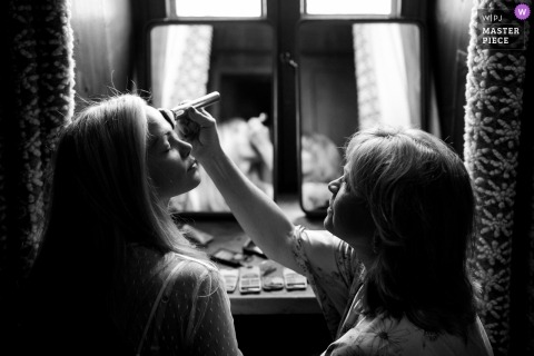 French wedding photography of bride getting makeup | Chamonix, French Alps