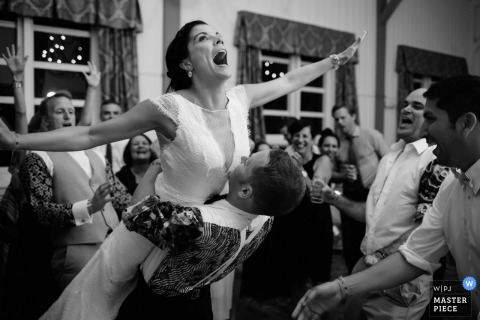 The bride takes flight on the dance floor at this Ripton, Vermont wedding reception party