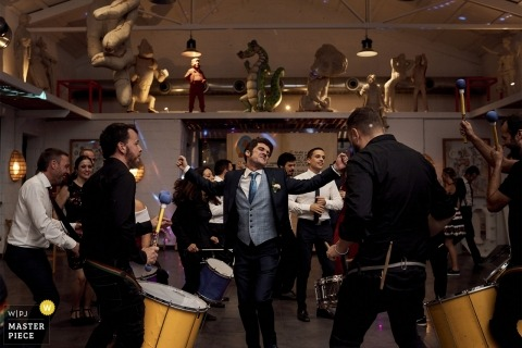 The grove or a groomsman dances to his own drum beat at the reception