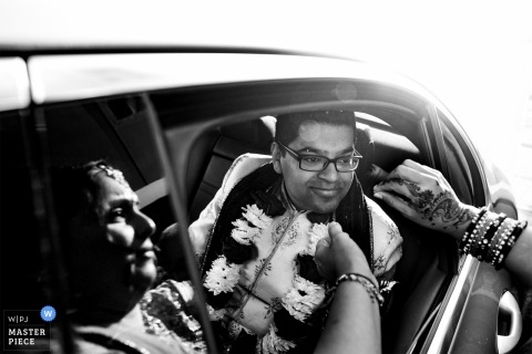 H Suite, Edgbaston, Birmingham, England - Wedding Photograph of groom in the back of a limo