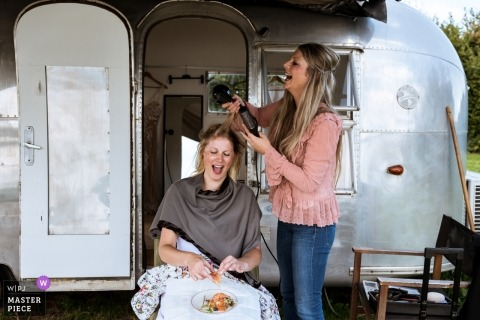 Oosterhout - The Netherlands wedding venue - the bride prepares her hair before a SilverStream camper