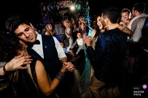 Genoa wedding reception dance party photography by ho Chi Minh Vietnam photographer
