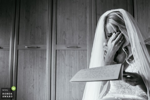 Bride gets emotional while reading a letter from the groom in Clitheroe, uk
