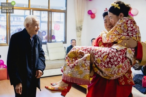 Grandfather happy to see the newlywed couple in China