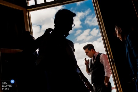 Istanbul groom and groomsmen get dressed and smoke cigarettes while getting ready