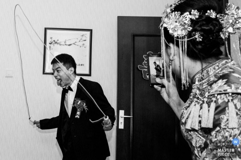 China beijing groom jumping rope during traditional door games for the bride