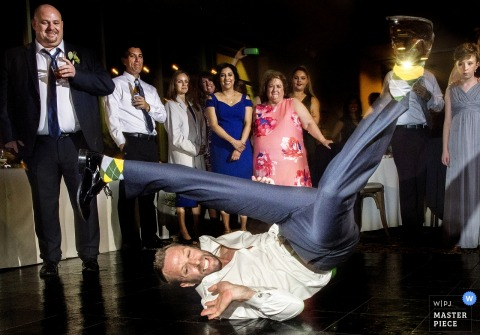 Phoenix Arizona wild reception party - male wedding guest breakdancing on the floor