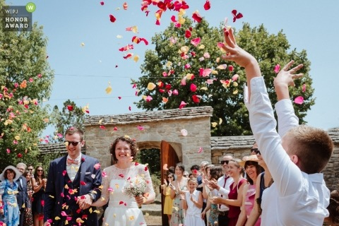 Bride and groom happy after the ceremony in France - Lot wedding photography of confetti