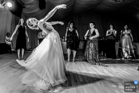 Wedding photo of a bride dancing elegantly at her Bucharest reception party