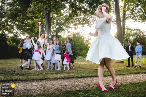 Wedding photo from Bouquet toss by the bride in Paris Park like reception