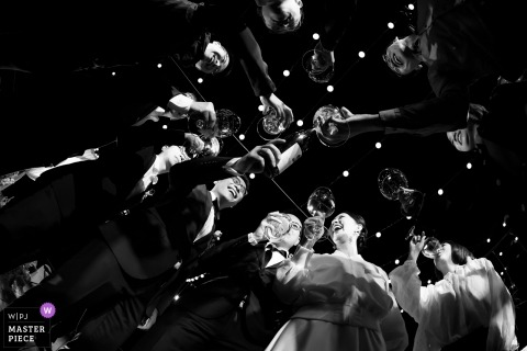 Shandong wedding photography of the bridal party toasting, as seen from below