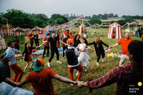 England wedding shoot with a couple celebrating and dancing at their festival carnival wedding day reception