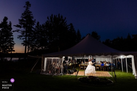 The first dance under the deep blue sky | Southport Maine wedding photography under a tent