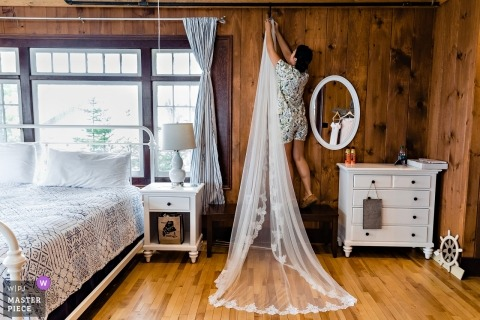 The bride, Safely hanging up the veil | Linekin Bay Resort Boothbay Harbor Maine