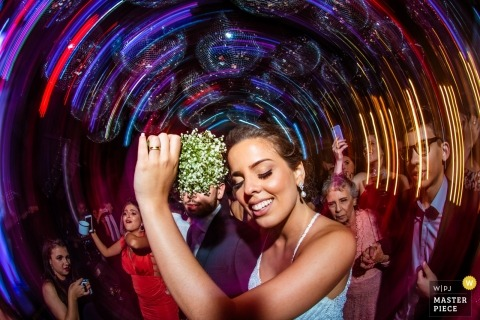 Minas Gerais wedding photograph of woman dancing to a slow shutter speed