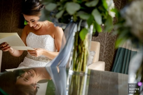 Raddison Hotel, Corning NY wedding photo of the bride reading a letter from her fiancé | emotional wedding photography