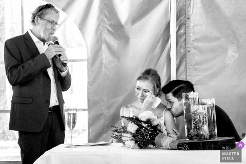 Zephyr Cove, Lake Tahoe wedding photograph of father reading speech to crying bride.