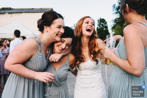 Nottinghamshire wedding photograph of a bride laughing it up with her best friends at the reception