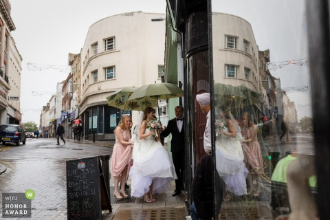 Sands Hotel, Margate Kent - Wedding Photograph of bride entering building out of the rain