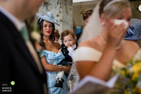 All Saints Church, Boughton Alumph, Kent Wedding Photograph of bride wiping tears