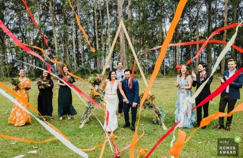 Bawley Point NSW Australia Wedding Photograph of guests throwing streamers at bride and groom after ceremony