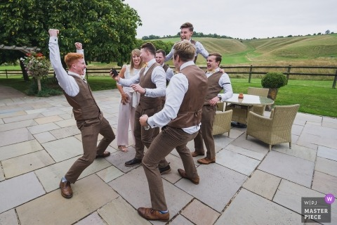Wellington Barn, Calne UK Wedding Photograph of groomsmen getting rowdy