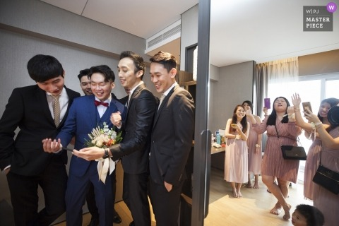 Singapore wedding photograph of the groom and groomsmen about to participate in a traditional door games