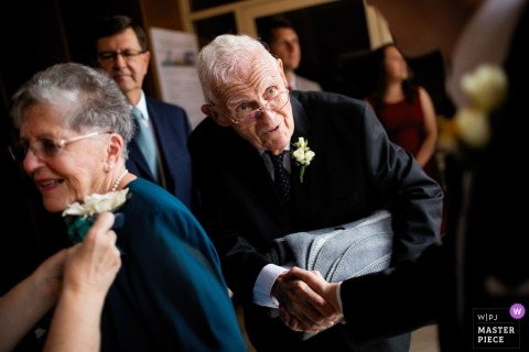 Providence wedding photo of an elderly couple having corsage pinned and shaking hands | Rhode Island wedding photography