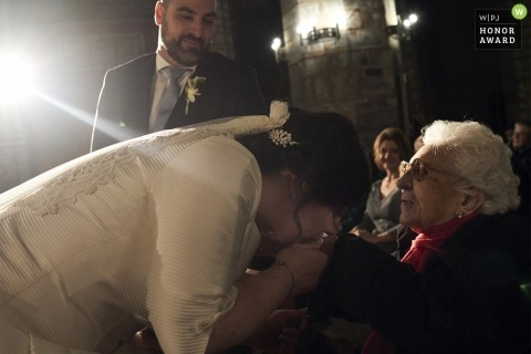 Valencia bride kissing in the hand of her grandmother during the wedding