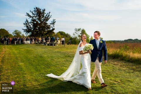 Ceremony exit at kennebunk, maine | A Funny Tale as Newlyweds