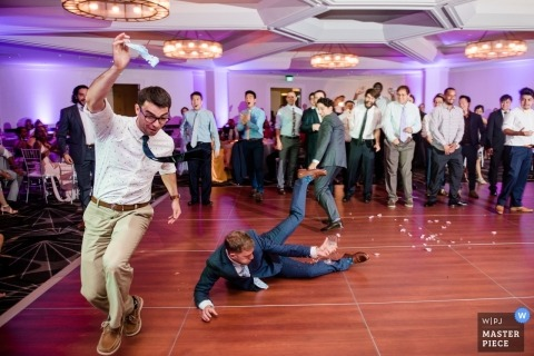 Single men fight for the tossed garter in this Westin Hotel, Boston MA wedding photograph