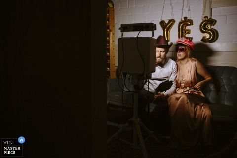 Wedding shoot with Aachen couple dressed up and playing for the camera at the Photo Booth