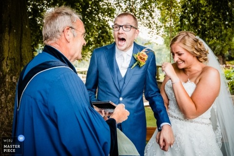 Wedding shoot with Landgoed couple and officiant/Celebrant laughing after the ceremony