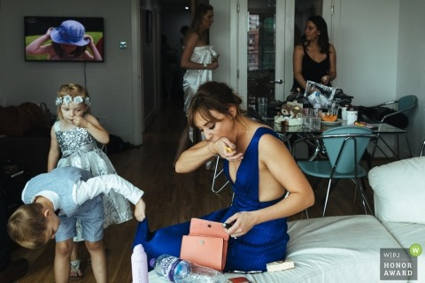 London wedding photo of a flower girl and ring bearer getting ready with the women by a photographer