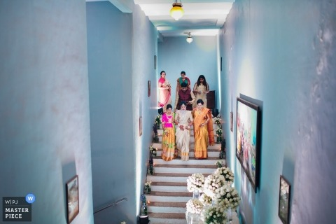 Hyderabad, India wedding photo of the bridal party ascending stairs | wedding photography in color