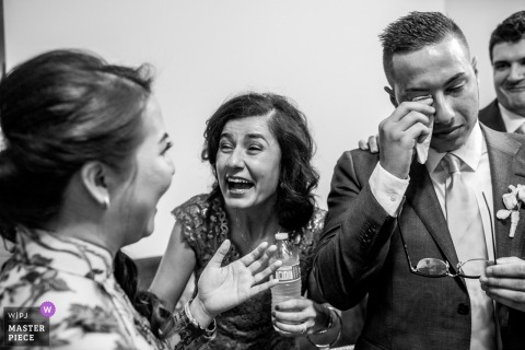 Wedding photo shoot in Atlanta with emotional guests and crying groom