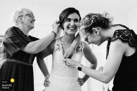 Getting ready with help - Bride at the Château du Breuil