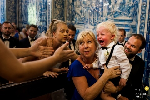 Algarve, Portugal wedding photo of a young ring bearer crying during the ceremony