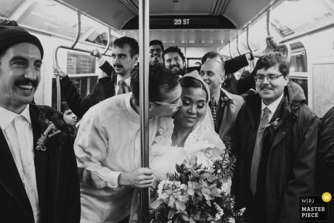 New York couple during using public transportation at their wedding