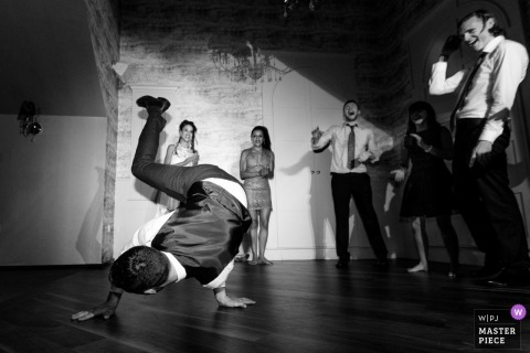Galway documentary wedding photo of a guest breakdancing on the reception dance floor