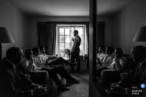 Dublin wedding photo of the groom and groomsmen hanging out while getting ready | wedding photographs in black and white