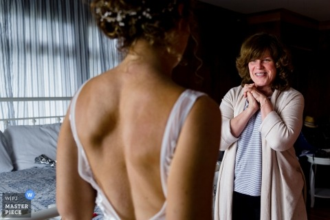 The bride's godmother marvels at the bride in her dress | Linekin Bay Resort Boothbay Harbor Maine