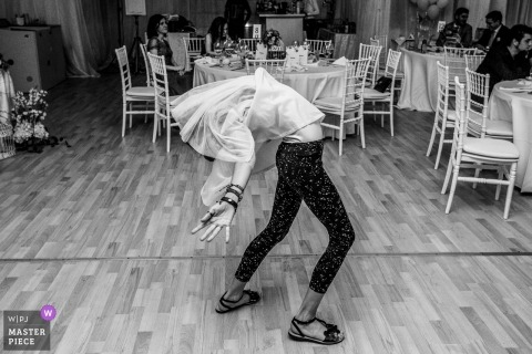 Bucharest wedding photograph a young girl dancing solo during the reception