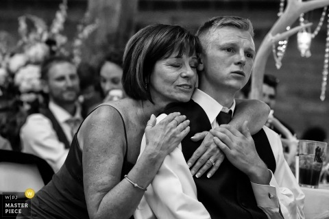 Graeagle, California wedding photo of mother hugging her son, the groom