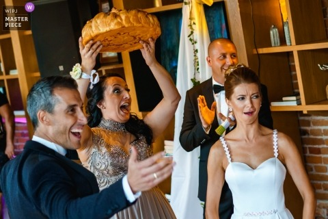 Documentary wedding photography at Karlovo, Bulgaria about to Break the traditional bread