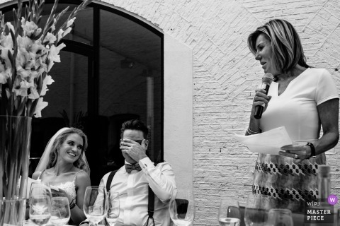 Naarden groom covers his face during their wedding reception speeches