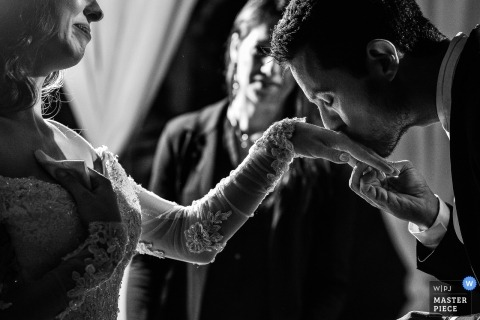 Wedding shoot with Valinhos groom kissing the hand of his bride