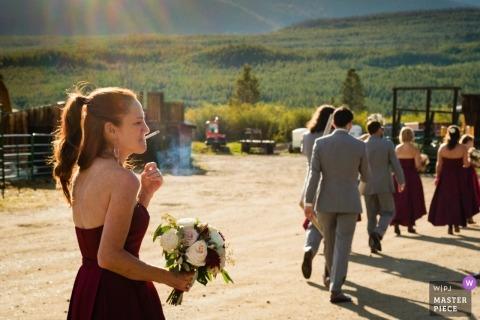 Grand Lake Colorado wedding photograph of bridesmaid following behind the bridal party.